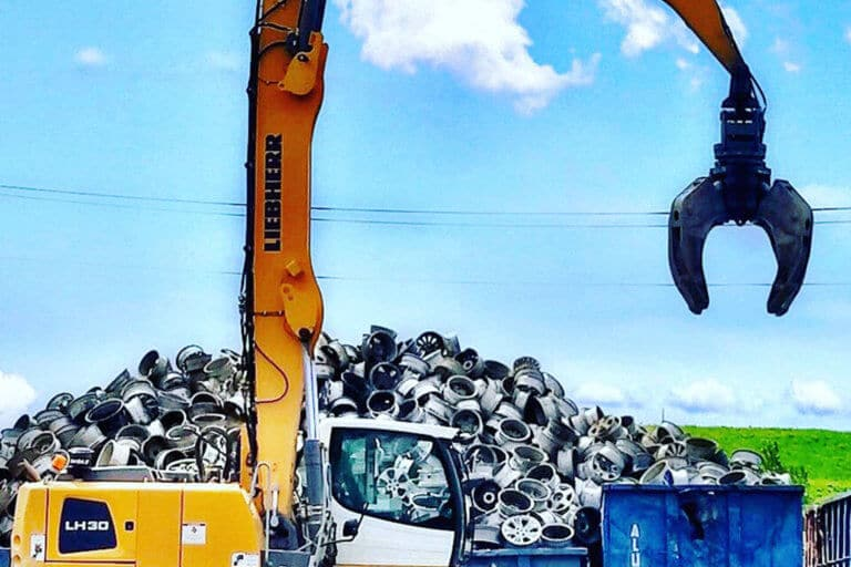 A pile of automobile wheels sold as scrap at upstate Shredding