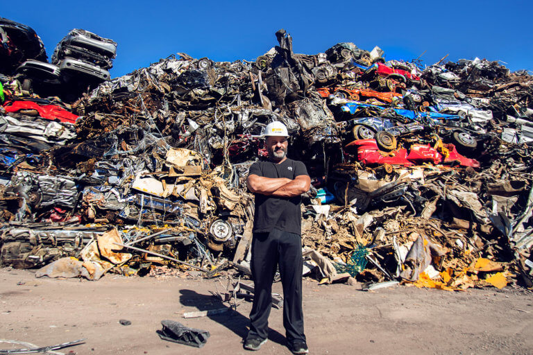 Adam Weitsman and load of cars to be recycled at Upstate Shredding