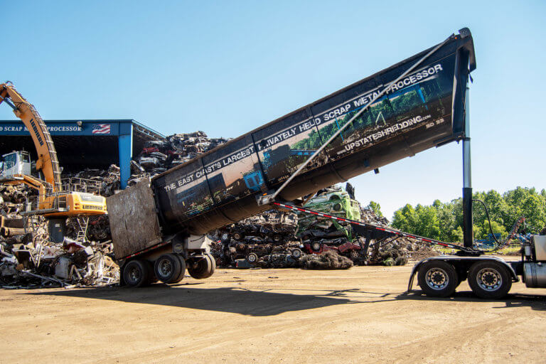 An Upstate Shredding tractor trailer loading recycled metal