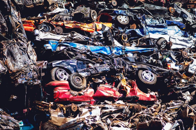 A pile of cars that will be recycled at Upstate Shredding